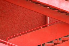 Red staircase near the red wall. Stock Images