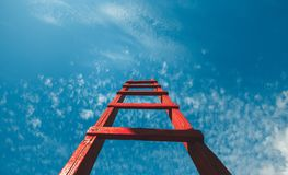 Red Staircase Rests Against Blue Sky, Front View. Development Motivation Career Growth Concept royalty free stock photo