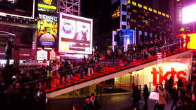 Red stairs at Times Square TKTS pavillion USA cityscapes stock video footage