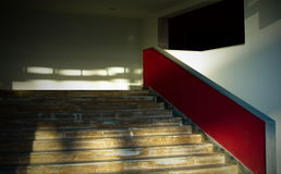 Red stairway. Detail of a residential building entrance Stock Photo
