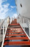 Red Stairways. To the Board of a Retired Naval Ship Berthed in Seashore for Sightseeing Stock Photos