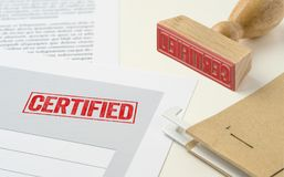 Certified. A red stamp on a document - Certified stock images