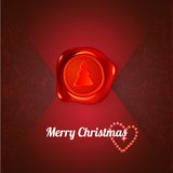 Red stamp with xmas tree on red letter Royalty Free Stock Image
