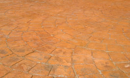 Red Stamped Concrete Patio in Backyard Stock Photo