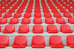 Red stand. Partial view of a stadium stand with red seats Stock Photography