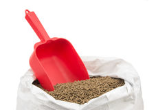 Red standard scoop for measuring horse feed Royalty Free Stock Photo