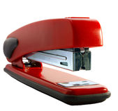 Red stapler. On a white background royalty free stock photography