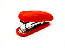 The red stapler. Lies on a white background Stock Photos