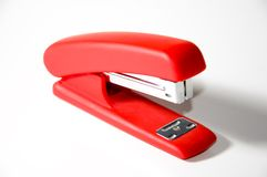 Red stapler. On white background royalty free stock photos