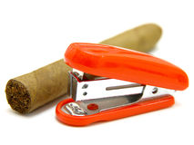 Red stapler and cigar Royalty Free Stock Photography