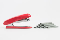 Red stapler isolated on white with mag Royalty Free Stock Image