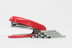 Red stapler isolated on white with mag Royalty Free Stock Images