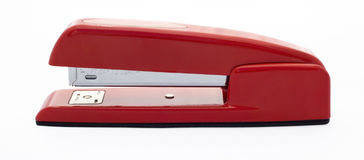 Red Stapler. Red office supply stapler isolated on white. Side view Stock Image