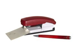 Red stapler with paper and pen Royalty Free Stock Photo
