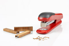 Red stapler and staples Royalty Free Stock Images