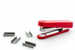 Red Stapler with staples wires. Stock Photo