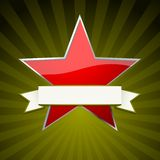 Red star. With ribbon over festive green background Royalty Free Stock Photos