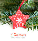 Red star on background of green fir branches Stock Images