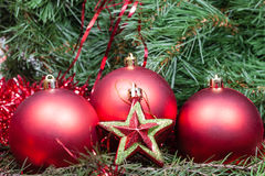 Red star, baubles on Christmas tree background Royalty Free Stock Photography