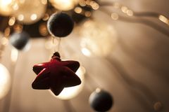 Red star on beige background. Christmas decorations. Red star on beige background. glowing fuzzy balls. Christmas decorations Royalty Free Stock Image