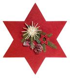 Red star and christmas decoration. Frontal shot of some christmas decoration with red felt star, isolated on white with clipping path royalty free stock image