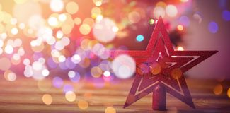 Red star Christmas decoration. On wooden table Stock Photo