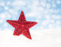 Red star Christmas ornament in snow Stock Image