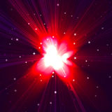 Red star flash. On a dark background Royalty Free Stock Image