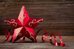 Red star , gifts and ribbons on wooden board Royalty Free Stock Photos