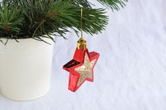 Red star with gold on Christmas tree Stock Photos