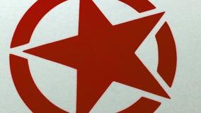 Red Star grafisk sprej som målas på yttersida arkivfilmer