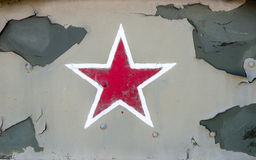 Red star on the gray paint cracked pieces of iron plates Royalty Free Stock Photo