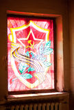 Red star, hammer and sickle, sabers (swords) Stock Image