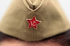 Red star on his cap, Hammer and sickle.  stock photography