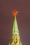 Red Star of Moscow Kremlin tower. Moscow Kremlin in winter night. The spire of Borovitskaya tower with red ruby star on top. The star is illuminated by the Royalty Free Stock Photography