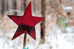 Red star preserved in the cemetery from the Soviet Union, the burial of Soviet soldiers in the forest during the Second World War. Red star preserved in the stock photos