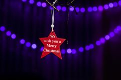 Red star with slogan: We wish you a Merry Christmas. stock image