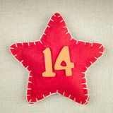 Red star with wooden number 14 Royalty Free Stock Image