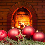 Red star and Xmas bubles and home fireplace Royalty Free Stock Image