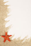 Red starfish on sand from sea Royalty Free Stock Photography