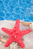 Red starfish with sea spa treatment setting stock photos