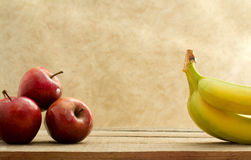 Red stark apple and banana bunch Royalty Free Stock Photo