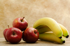 Red stark apple and banana bunch Royalty Free Stock Photography