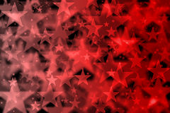 Red stars background with bokeh effect Royalty Free Stock Images