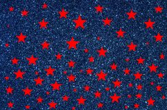 Red stars on blue glitter background Stock Photo