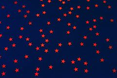 Red stars on a dark blue background. royalty free stock photo