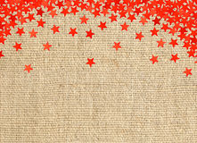 Red stars on linen texture Royalty Free Stock Photos