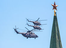 Red stars of Moscow Kremlin and military helicopters on the Victory day Royalty Free Stock Photo
