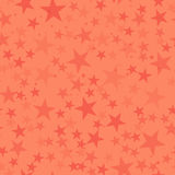 Red stars seamless pattern on coral background. Stock Photos
