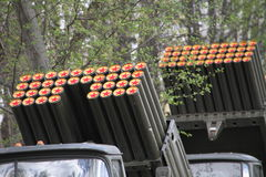 The red stars on the trunks of guns. Red stars on the barrels of guns on the background of trees Stock Photo